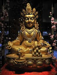 There are several different forms or manifestations of Dzambhala (also spelled as Jambala or Dzambala). Dzambala is a Buddhism Wealth God. The one in the picture is the most common or most famous manifestation of Dzambhala which is the Yellow Dzambhala.