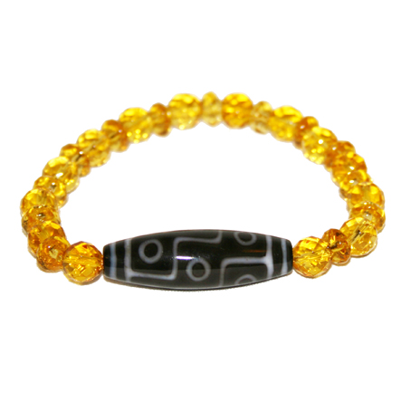 Nine Eye DZI Bead on a string of Citrine.