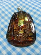 From my personal collection. A rare Red Amber Ksitigarbha. If wearing it as a pendant, I prefer the image with the five leave crown. Unfortunately, it is quite difficult to get a Ksitigarbha pendant unless you're from Malaysia, Hong Kong, or Singapore.