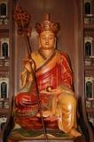 In looking for an image of Ksitigarbha Bodhisattva either as a pendant or a figurine for your home, you will come across with two versions, the one with the 'Amitabha' hat and the one where He is not wearing any hat and shows his bald head. I prefer the one with the hat, because the one where He is bald is usually associated with the spirits of the dead and connotes that he hasn't attain His Buddhahood.