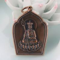 Look for gold Ksitigarbha Bodhisattva / Earth Store Bodhisattva similar to this one. Please note that this seems to be Bronze. However, what we need is gold.